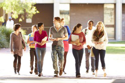 international students walking on campus grounds